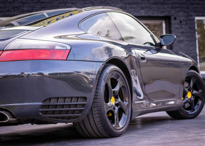 Porsche-911-4s-repair-gutter-rash-spray-paint-full-satin-black-custom-paint-calipers-yellow-with-black-porsche-text-center-caps-yellow
